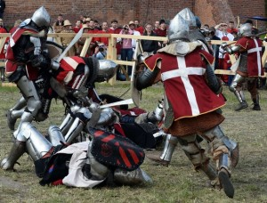 Austrian and Danish knights fight in the 10 vs10 competition in Medieval Combat World Championship at Malbork Castle on May 3, 2015. AFP PHOTO/JANEK SKARZYNSKI